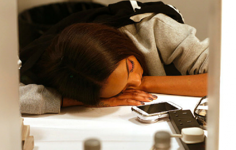 Model Sleeping With A Phone In Front Of Her