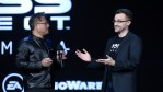 Nvidia Founder, President and CEO Jen-Hsun Huang (L) speaks with BioWare general manager Aaryn Flynn as they introduce footage of the new 'Mass Effect: Andromeda' video game.