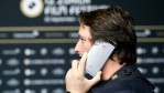 A visitor uses a Huawei phone during the 12th Zurich Film Festival on September 26, 2016 in Zurich, Switzerland.