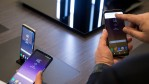 Attendees use the new Samsung Galaxy S8 at the launch event, March 29, 2017 in New York City.