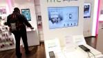 HTC phones lie on display at a shop of German telecommunications provider Deutsche Telekom.