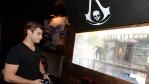 Actor Garrett Clayton playing the Sony PlayStation 4.