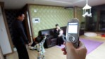 Moon Sook-Kyung (28), controls an electronic appliance of her house with her mobile phone on November 29, 2006 in Incheon, South Korea.