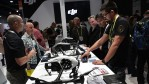Attendees check out dones at the DJI booth during CES 2017 at the Las Vegas Convention Center on January 5, 2017 in Las Vegas, Nevada.