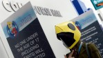 A gamer poses with a face mask from the ocean exploration video game 'Abzu' during annual E3 2016 gaming conference at the Los Angeles Convention Center on June 14, 2016 in Los Angeles, California.