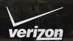 A sign hangs outside of a Verizon store on April 20, 2017 in Chicago, Illinois.